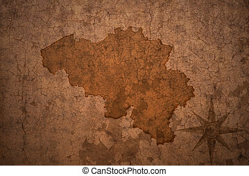 belgium map on vintage crack paper background - belgium map...