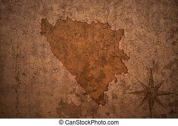 bosnia and herzegovina map on vintage crack paper background...