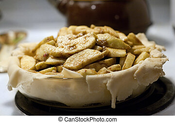 Deep Dish Apple Pie - A homemade deep dish apple pie being...