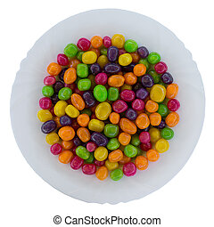 dragee candies in a plate on a white background