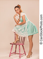 Can I put the dress like that? - Young woman standing with...