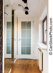 Corridor in house - Narrow bright corridor in house with...