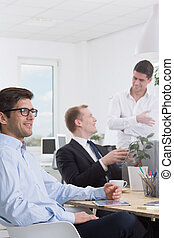 Satisfied with the project - Talk of men employees in the...