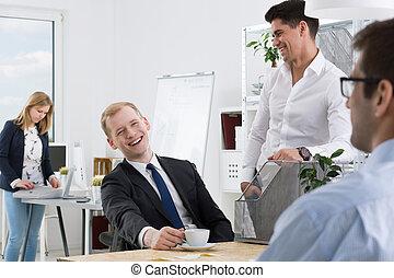 Sense od humour at work - Elegant workmates joking in the...