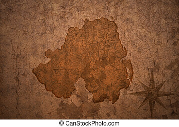 northern ireland map on vintage crack paper background -...