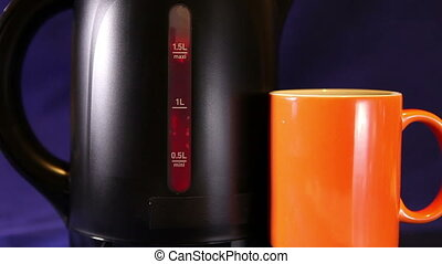 electric kettle and a mug, measured mark water level red...