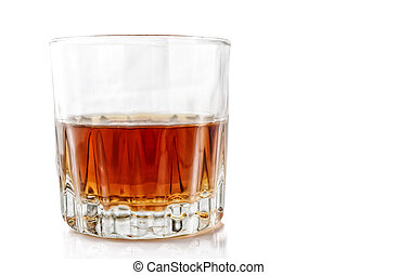 Glass with alcohol on a white background.