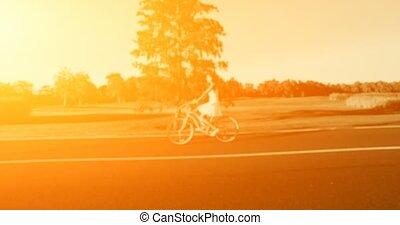 Beautiful girl rides on the vintage bike. 4k, 25 fps - 4K...