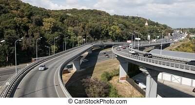 City highway interchange carry rush hour traffic - City...