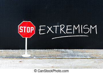 STOP EXTREMISM message written on chalkboard - Mini STOP...