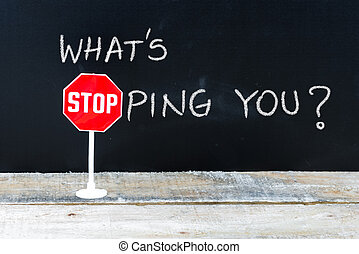 WHAT IS STOPPING YOU message written on chalkboard - Mini...