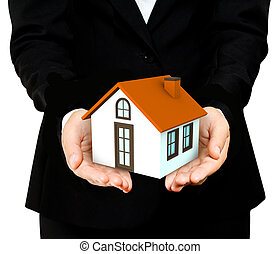 Woman hands saving small house