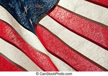 Series of ruffled flags against sun - USA - Flag blowing in...