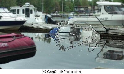 shipwrecked motor boat sinking in the harbor