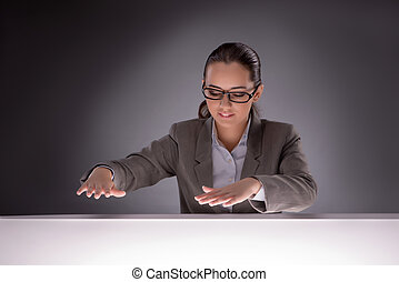 Young businesswoman working on the table