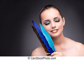Beautiful woman with writing feather quill