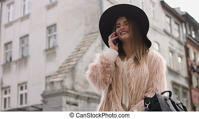 Cell phone - woman talking on smartphone in city