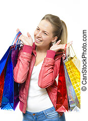 Happy Shopper - A cute girl holding shopping bags on white...