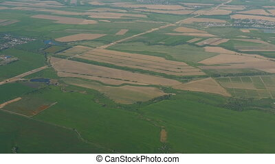 View from the airplane taking off - Panorama of agricultural...