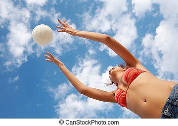 Throwing ball - Photo of energetic girl in bikini playing...