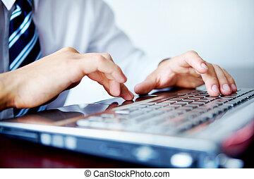 Laptop work - Businessman typing on his laptop