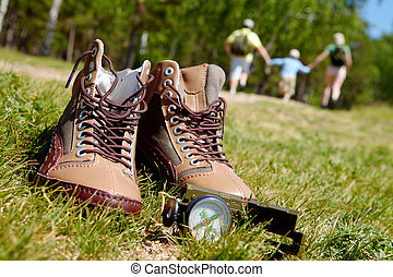 Trip equipment - Image of pair of boots and compass on...