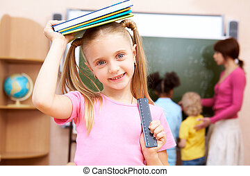 Schoolgirl - Portrait of happy schoolgirl with textbook on...