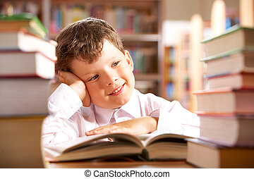 Schoolboy - Portrait of smiling schoolboy sitting at the...