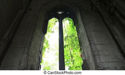 Window opening in ancient stone crypt at graveyard - Broken...
