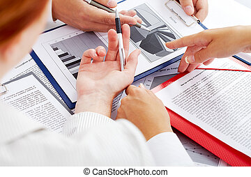 At seminar - Close-up of business partners hands during...