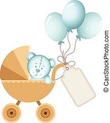 Boy teddy bear in baby carriage