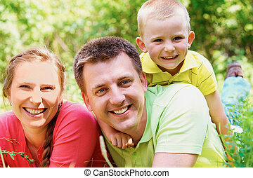Family on vacation - Portrait of cheerful family on summer...