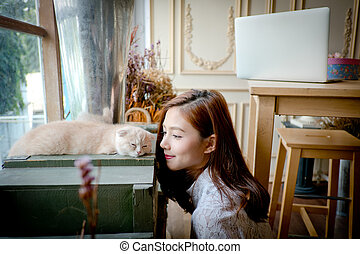 A little girl with a cute cat .