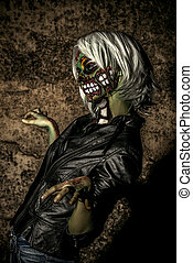 furious halloween - Terrible bloodthirsty zombie woman in...
