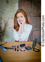 The Beautiful woman with a set of cosmetics