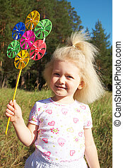 Cutie - Portrait of cute girl with fair hair playing with...