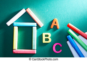Elementary school objects - Close-up of chalk house, letters...