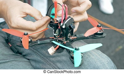 Assembling FPV drone preparing quadcopter flight - Close up...