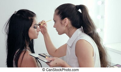 Make-up artist applying makeup - makeup artist doing makeup...