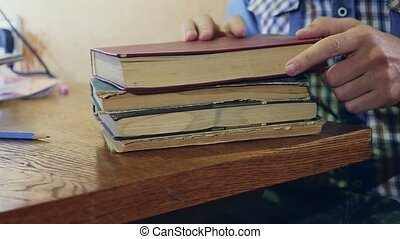 man reading old book close-up turns the page education video...