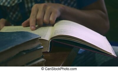 man reading an old book close-up Leafs education video - man...