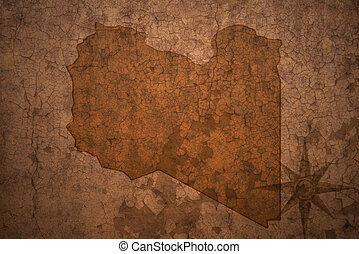 libya map on a old vintage crack paper background