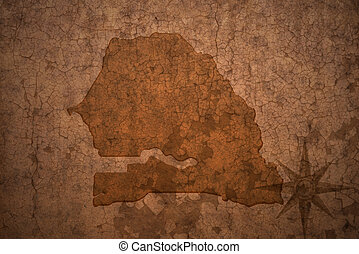 senegal map on a old vintage crack paper background