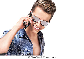 Portrait of a handsome man talking on the phone