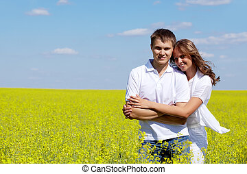Togetherness - Image of joyful girl embracing her boyfriend...
