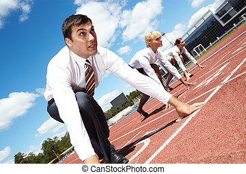Career - Row of business people getting ready for race with...
