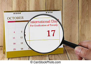 Magnifying glass in hand on calendar you can look...