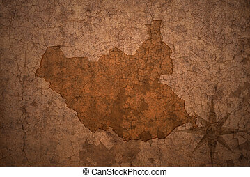 south sudan map on a old vintage crack paper background