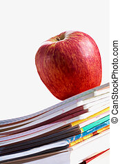 Red apple on copybooks - Stack of copybooks with big red...