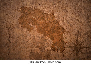 costa rica map on a old vintage crack paper background